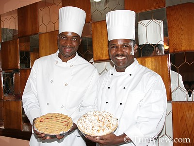 RIGHT: Chef, Andrew Belle and his assistant Willis Sinnette display a Cherry Pie and a Lemon Meringue Pie