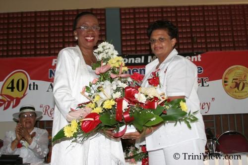 Senator the Honourable Joan Yuille-Williams receives a token of appreciation from Councillor Denise Aleong-Thomas