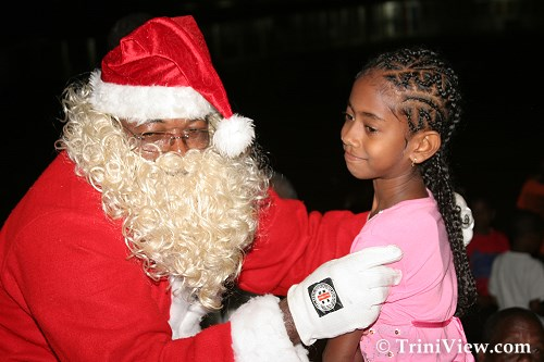 Santa Claus presents gifts to the children